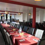 Salle de petit-déjeuner du Green des Impressionnistes spécialement aménagée pour un évènement type séminaire